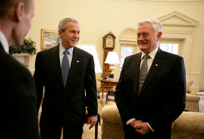 President George W. Bush is introduced to officials accompanying Lithuania's President Valdas Adamkus Monday, Feb.12, 2007, during the leader's visit to the White House. White House photo by Eric Draper.