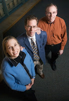 Nancy Sottos, professor of materials science; Scott White, professor of aerospace engineering, center; and Jeffrey Moore, professor of chemistry, have collaborated again. The inventors of self-healing plastic have come up with another invention: a new way of doing chemistry. Photo by L. Brian Stauffer.