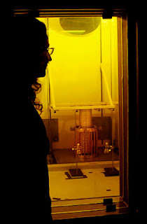 Tina Nenoff observes an experiment to create superalloy nanoparticles in a testing cell at the Gamma Irradiation Facility. (Photo by Randy Montoya)