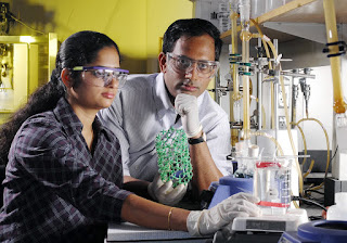 Sankar Nair, an assistant professor in the Georgia Tech School of Chemical and Biomolecular Engineering, and graduate student Suchitra Konduri, show a model of the metal oxide nanotubes they are developing. The research could lead to a technique for precisely controlling the dimensions of the structures. Georgia Tech Photo: Gary Meek.