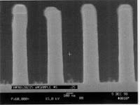 Schematic of an energetic (100s of eV) neutral beam source (left) and SEM picture of quarter-micron wide features (right) etched with this source in polymer using an O-atom beam. Neutral beam sources can mitigate charging effects that can cause serious problems in advanced microelectronics fabrication. Images: University of Houston Cullen College of Engineering