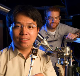 Caption: Ian Appelbaum (right), UD assistant professor of electrical and computer engineering, and doctoral student Biqin Huang are making pioneering discoveries in spintronics, which seeks to harness an electron's spin in addition to its charge to make cheaper, faster, less power-hungry electronics. Credit: Kathy F. Atkinson/University of Delaware. Usage Restrictions: Image must include credit to University of Delaware.