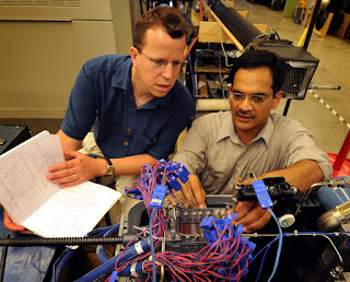 Eckhard Groll, at left, a professor of mechanical engineering, and Suresh Garimella, the R. Eugene and Susie E. Goodson Professor of Mechanical Engineering