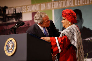 President George W. Bush embraces Liberian President Ellen Johnson Sirleaf