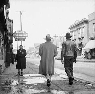 Detroit, Michigan. Back view of a Negro dressed in a zoot suit, walking in the business district