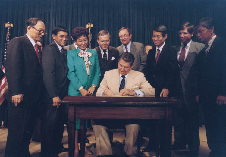President Reagan signs Civil Liberties Act of 1988