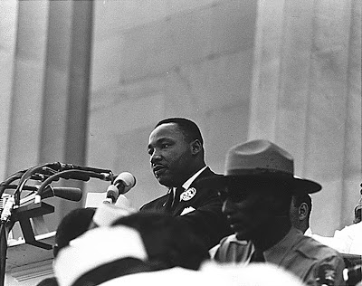 Dr. Martin Luther King, Jr. speaking as Edward B. Footmon of the National Park Service looks on Civil Rights March on Washington