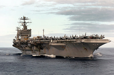 The Nimitz-class aircraft carrier USS John C. Stennis (CVN-74) cruises through the calm waters of the Pacific Ocean, October 19, 2004. John C. Stennis and embarked Carrier Air Wing Fourteen (CVW-14) were on a scheduled deployment to the Western Pacific Ocean. U.S. Navy photo by Photographer's Mate Airman Charlie Whetstine