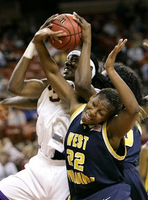 LSU center Sylvia Fowles (34) grabs the rebound from West Virginia forward Chakhia Cole (22) in the first half of their second round basketball game at the NCAA women's Division I tournament in Austin, Texas, Monday, March 19, 2007