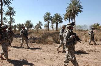 U.S. Army Soldiers from A Battery, 2nd Battalion, 15th Field Artillery Regiment, 10th Mountain Division (Light Infantry), along with Iraqi Army Soldiers, conduct a foot patrol through an area that has been frequented with attacks on Coalition forces, March 4. U.S. Army photo by Sgt. Jacob H. Smith.