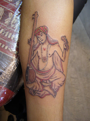 Here's a picture of the tattoo. Musically, Shashikiran
