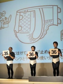 Japanese models wear the latest style of adult diapers during a fashion show ...
