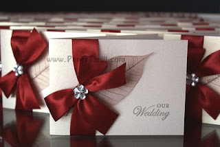 Handmade red ribbon wedding invitation cards