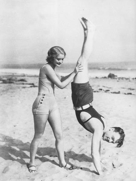 Cagney Doing a Handstand on the Beach