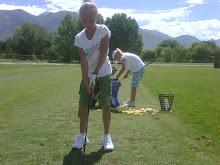 Kelsie golfing