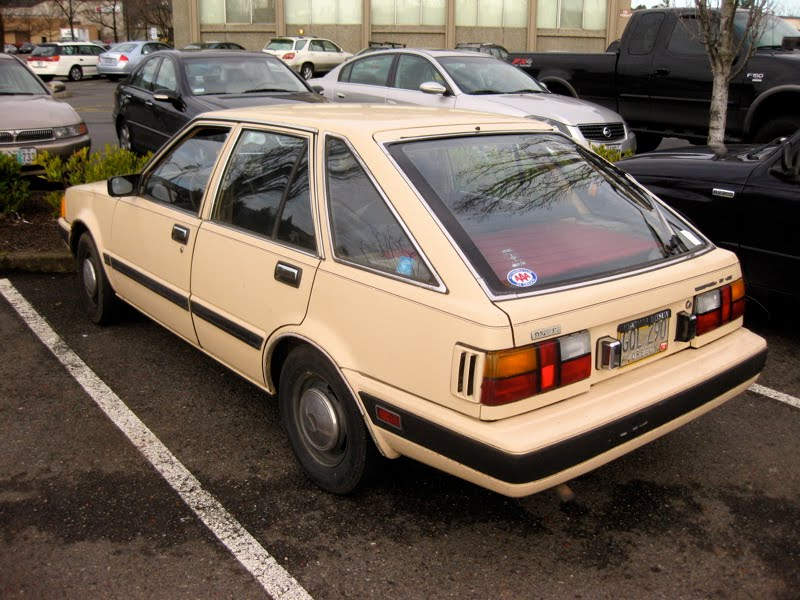 OLD PARKED CARS.: 1983 Datsun/Nissan Stanza 4-Door Hatchback.
