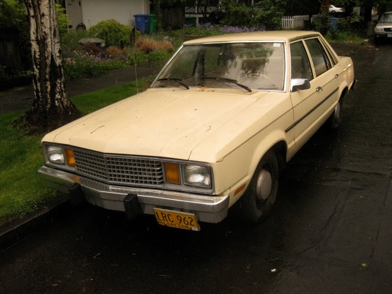 OLD PARKED CARS.: 1979 Ford Fairmont Sedan.