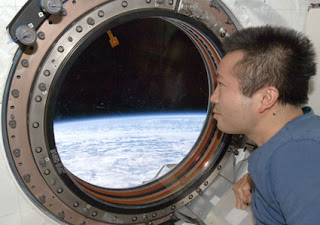 Expedition 19 Flight Engineer Koichi Wakata looks through a window in the Kibo laboratory of the International Space Station.