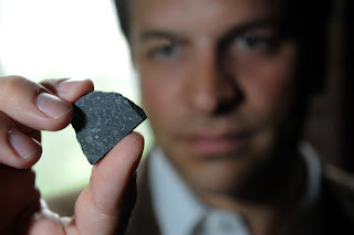 University of Chicago scientist Philipp Heck with a sample of the Allende meteorite.