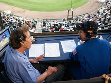 NASA astronaut Dr. John Grunsfeld talks with broadcaster Ed Farmer at the White Sox game during the 2009 Hometown Heroes campaign in Chicago