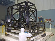 NASA engineers check out the unwrapped ISIM structure in a clean room