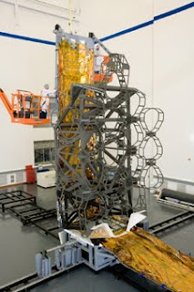These Webb telescope simulators are full-scale representations of the optical telescope element and sunshield