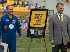 Astronaut Mike Fincke presents the space-flown Terrible Towel to Steelers President Art Rooney II during pre-game activities on Nov. 15