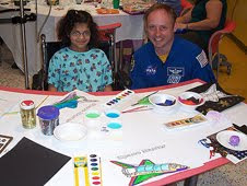 stronaut Mike Fincke works on space themed activities with patients at the Children's Hospital of Pittsburgh