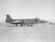 JF-104A #56-0749 on the ramp at NASA's Flight Research Center on Edwards Air Force Base in 1959 with the Air Launched Sounding Rocket (ALSOR) attached to its underbelly. NASA test pilot Milton O