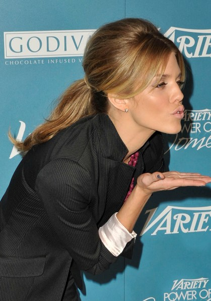 90210 star AnnaLynne McCord blew kisses and showed off her blonde hairstyle