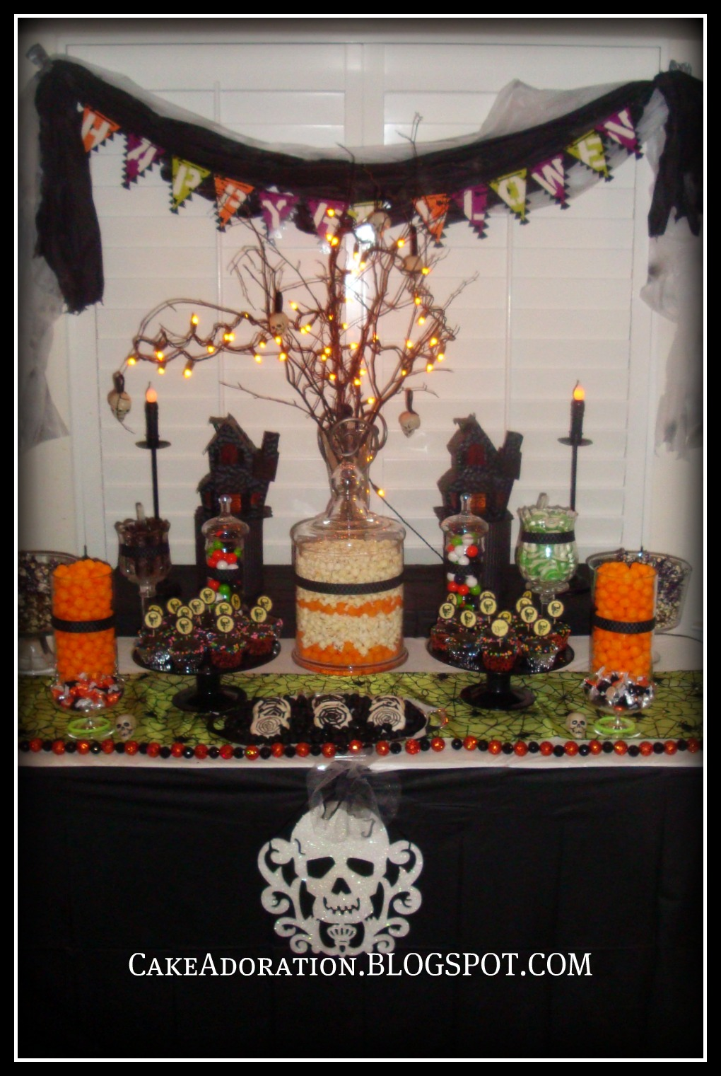 this adorable halloween table was a huge hit it was a combination of sweet and savory gumballs and chocolate licorice sour apple rings cupcakes