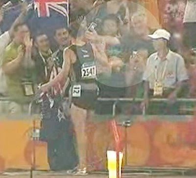 Mike O'Sullivan in the crowd at Beijing Olympics congratulates Nick Willis