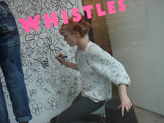 Artists draw designs for a Whistles' shop window. Photo by Lucia Carpio