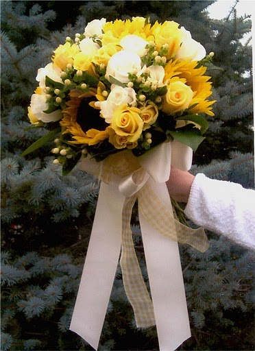 Medium yellow and white roses intermixed with stunning sunflowers