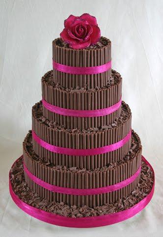 Beautiful dark chocolate curls four tier wedding cake with deep pink
