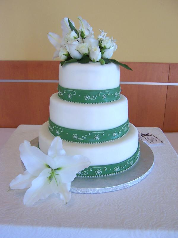 Simple and stunning four tier wedding cake in white with olive green satin