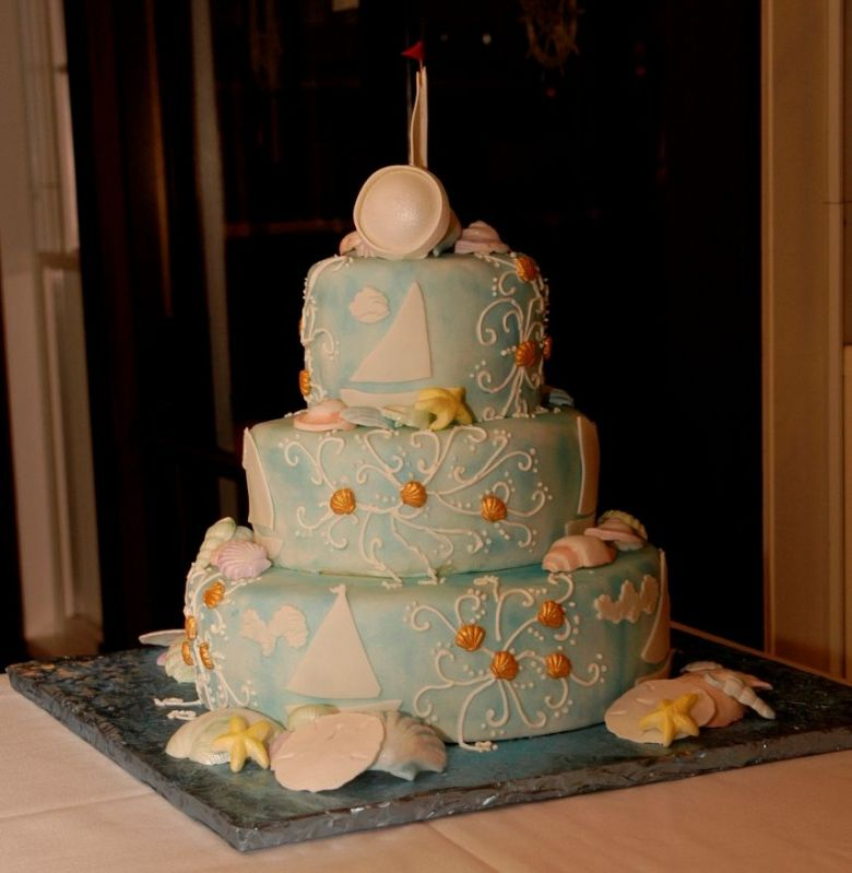 Light blue three tier round wedding cake in light blue with nautical theme
