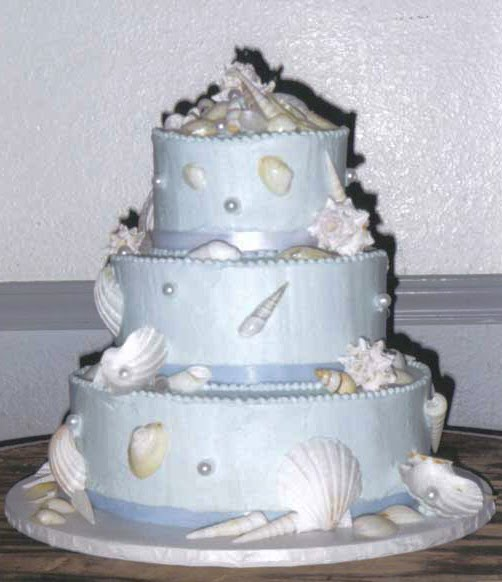 Two tier tiffany blue wedding cake adorned with white sea shells