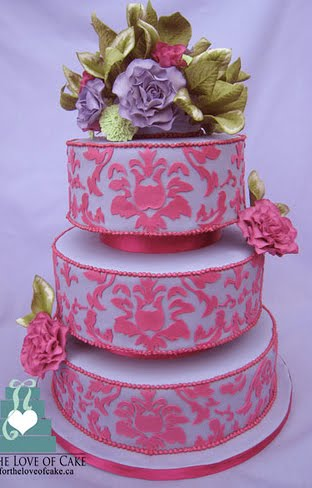 Silk Dress on Three Tier Round Wedding Cake With Pink Damask Pattern Over Light