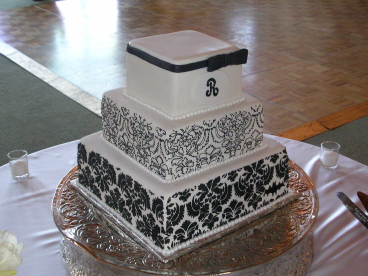 Four tier black and white damask wedding cake with dotted pattern on the top
