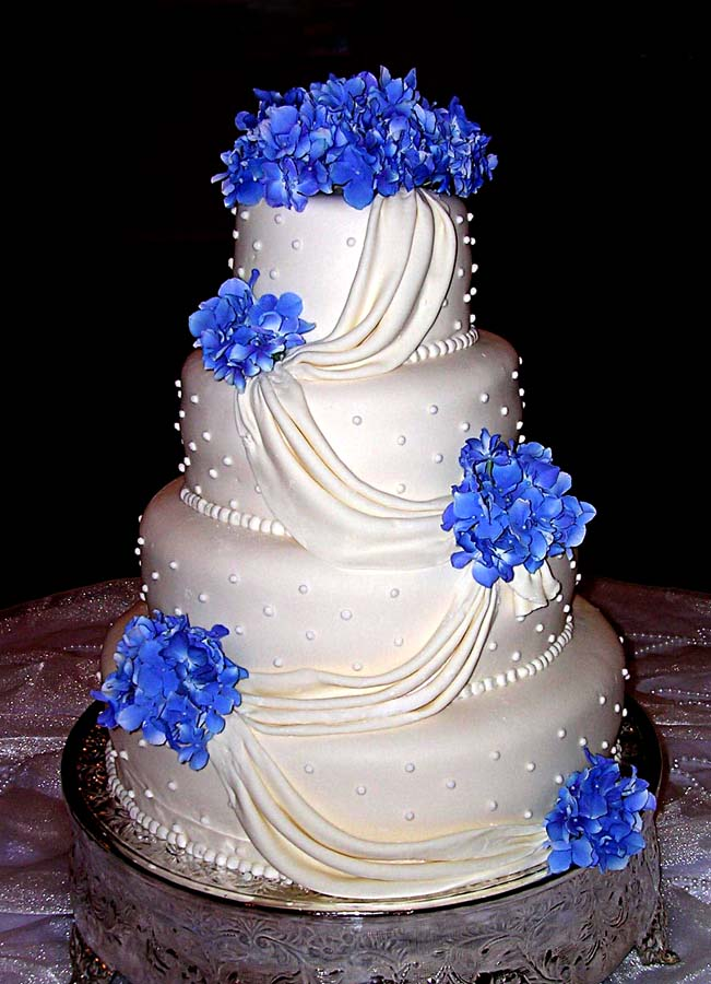 blue hydrange wedding cake drapping