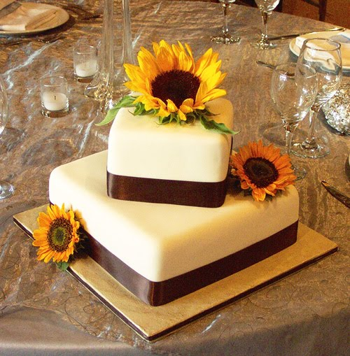 Elegant two tier square wedding cake with sunflowers