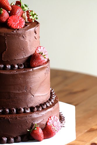 Three tier round chocolate wedding cake Four tier round chocolate covered