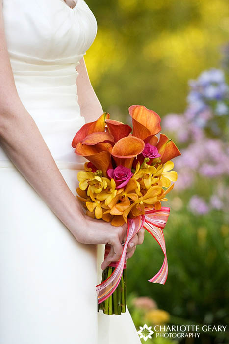 Mango calla lily bridal bouquet with yellow orchids