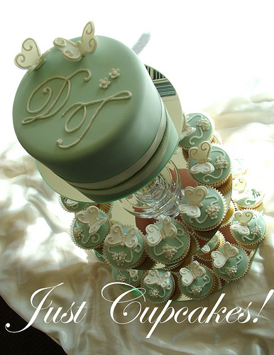 Wonderful green and white wedding cupcake inspiration with silver cupcake