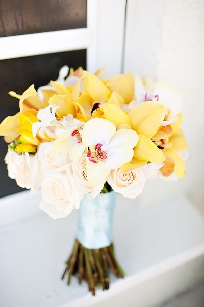 Yellow and white orchids with pale pink roses bridal bouquet