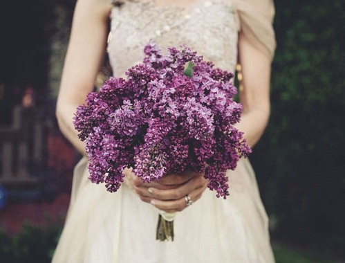 A gorgeous purple wedding bouquet from Martha Stewart including sweet peas