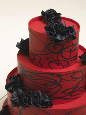 Black and red wedding cake with swirls