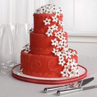 A Bright And Vivid Red Wedding Cake With Royal Feel Decorated White Roses Crown To Top It Off