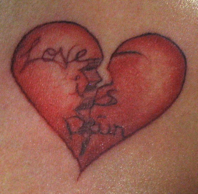 Tattoo: Original broken heart and script. Location: left chest, shoulder